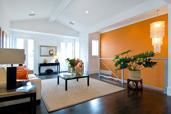 Bright-orangen-accent-wall-paint-colors-for-living-room-with-dark-hardwood-floors