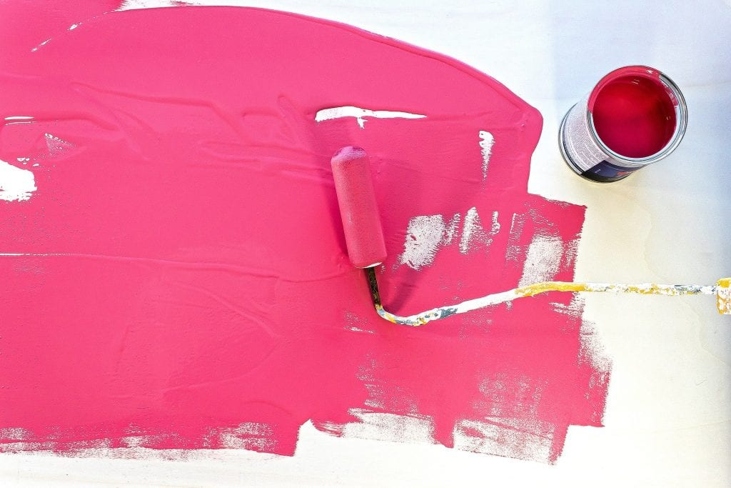 pink paint and roller