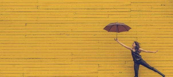 woman with umbrella floating