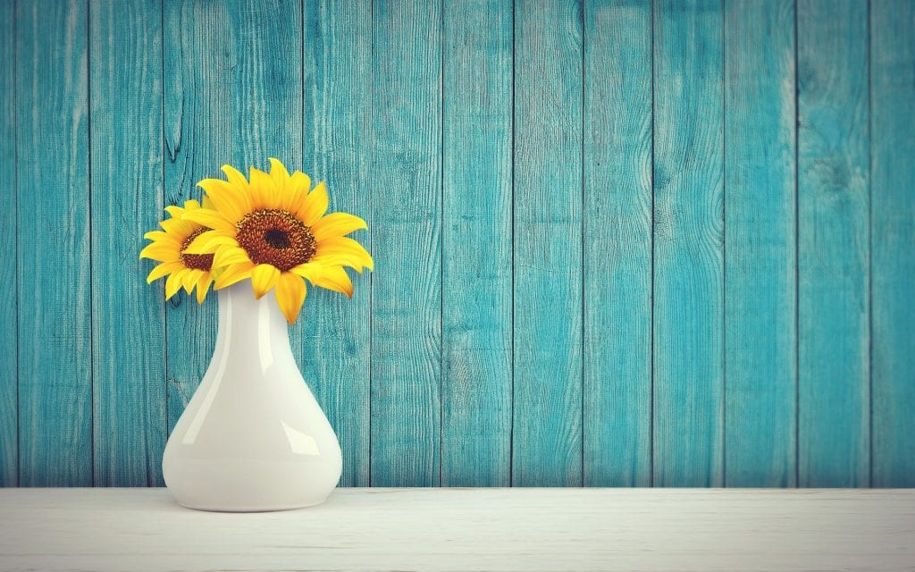 blue accent wall with yellow flowers
