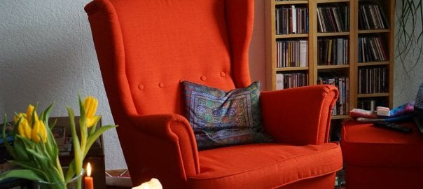 cozy reading nook with red chair